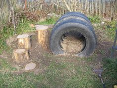 Tyre tunnel for outdoor play areas! Would look awesome if you painted them bright colours. #recycledtyres