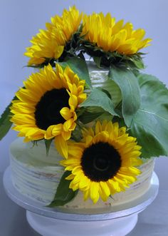 Wedding cake with fresh sunflowers