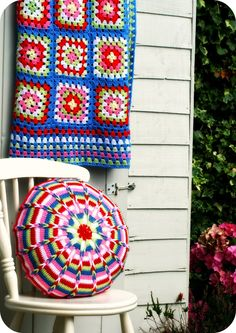 Granny square blanket and colourfull crochet cushion