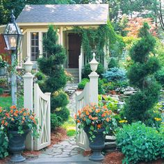 Make a Grand Entrance Plant artistically sheared evergreens (such as the junipers shown here) on both sides of your gate or along a path to give an entry a bolder, more formal feeling. They'll take yearly pruning to keep their swirly shape, but the effect is worth the effort.