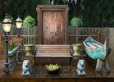 outdoor deck with door and lamp post.