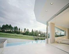 Retractable Glass Doors Design under Modern Home Decoration Ideas Used Beige Floor Design Ideas as Home Inspiration