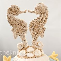 Would it be too selfish of me to choose my beloved Seahorses?  Their color would even go well with the cake colors!