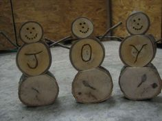 Homemade Wooden Log Snowmen. THESE ARE NOT MY IMAGES. I DO NOT TAKE CREDIT FOR THEM.