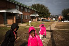 Children at the George Washington Carver housing project in Selma, where Ricky Brown saw marchers an... - Josh Haner/The New York Times