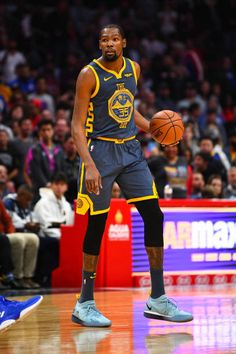 623efad004c Golden State Warriors Forward Kevin Durant sets up the offense during a NBA  game between the
