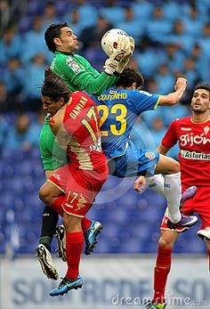 Juan Pablo Colinas(C) of Gijon block the ball between Damian(L) and Coutinho(R) during a Spanish League match against RCD Espanyol at the Estadi Cornella on April 28, 2012 in Barcelona, Spain