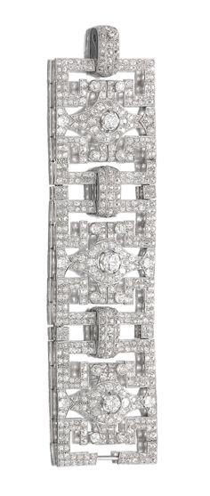 DIAMOND BRACELET, 1930S. The wide band of geometric open work design, set with cushion-shaped, circular- and single-cut diamonds, length approximately 175mm, French assay and maker's marks.
