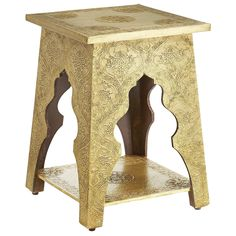 There's always something that speaks to you at Pier 1—this time with a Marrakesh accent. Our Moroccan-inspired table is covered in hand-embossed brass with patterns of an exotic Arabian tapestry. Cutouts of traditional Middle Eastern arches speak directly to the table's cultural origins. A handy lower shelf translates functionality beautifully. Quite the conversation piece, this one.
