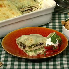 Mexican lasagna - I really wish I had bought some tomatillas this morning cause I want this NOW!