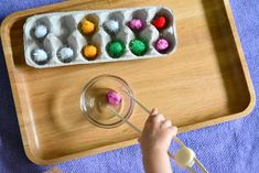 It looks silly to adults perhaps but, little people will sit and do this simple sorting and matching type activity and be absorbed by it.