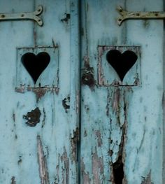 <3 rustic french blue wood doors with heart cutouts and strap hinges