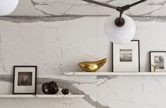Floating shelves, marble backsplash and gold accents? Perfect!