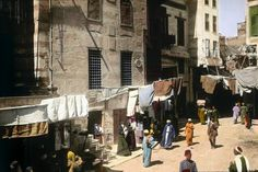 Laundry hanging in a Cairo street. | These Color Photos Of Cairo In 1910 Will Blow Your Mind