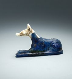 "Recumbent jackal                                                                                                                                                                                                           Blue and white glass.  Late Ptolemaic – Roman Period ""EGYPTIAN"", c. 200 BC – 100 AD"