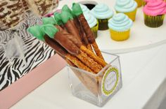Artist brushes - pretzel rods dipped in milk chocolate, and topped with a dolop of colored chocolate.