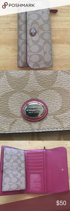 Coach wallet. Coach wallet with lots of storage! Change department in back, place for checkbook, multiple card slots, ID sleeve, and place for money. Great wallet! Has been used with a pin mark on checkbook sleeve. Coach Bags Wallets