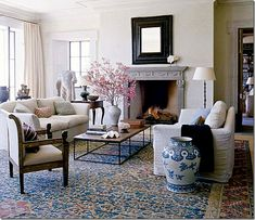The blues in the pots beautifully set off the blues in the carpet making this room very pleasing.