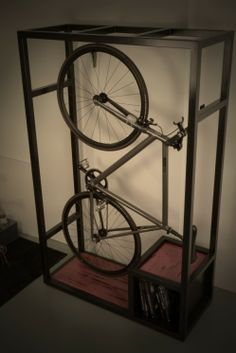 Bike Rack... i think my boyfriend would really like this, cool way to store his bikes in the apt