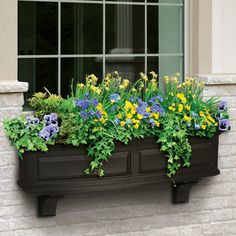 Love the corbels with the window box
