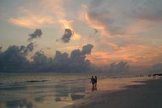 Couple walking along a beach at sunset by artist Pam Siderewicz   BVAA