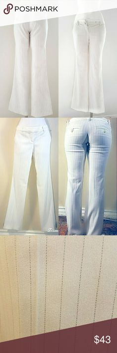 Host pick Guess white with black stripes flare Guess company white with black stripes flare slacks  94% polyester 5% rayon and 1% spandex. 31 inseam Fit a size 2-4.  $43 Guess Pants Boot Cut & Flare