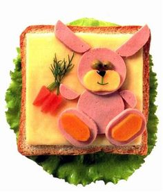 Adorable Rabbit Appetizer - Made from ham, cheese, olives, carrots, peas and dill.