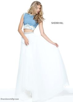 Sherri Hill 51197 is a 2-piece prom dress with a cap sleeved denim crop top and a tulle skirt.
