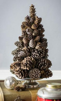 Love this DIY Rustic Pine Cone Tree! I would totally do this with the cinnamon scented pine cones! Pine Cone Christmas Tree, Tabletop Christmas Tree, Small Christmas Trees, Rustic Christmas, Christmas Crafts, Christmas Christmas, Natural Christmas Tree, Christmas Ideas, Primitive Christmas