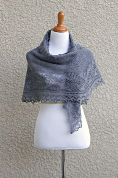 Knit shawl with laced border in grey color