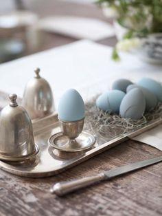 blue painted easter eggs on silver