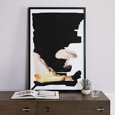 """With bold, contrasting colors softened by free-flowing forms, this framed print catches the eye, without clashing with other pieces in your space. • 24""""w x 36""""h. • Printed on watercolor paper. • Black frame. • Made in the USA.…"""