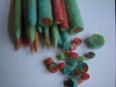 Make wet felt beads: wool roving, a bowl of warm water, dish soap and eager children to start the wet felting process. Rolling coils and threading. Great fine-motor activity. Perfect Mother's Day gift.
