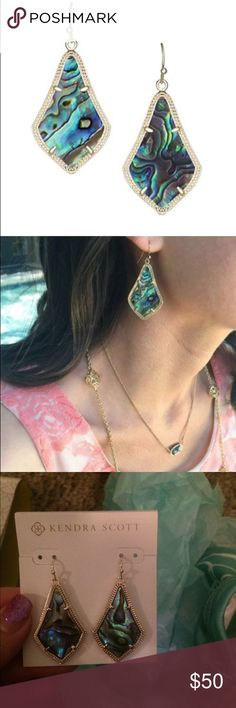 Kendra Scott Alex Earrings Abalone & Gold Plated This stunning pendalogue prism silhouette is inspired by gorgeous Moroccan lanterns and patterns. Shades of purple, blue, green and yellow radiate from natural abalone shell. Metal: 14k Gold Plated over Brass Note: Due to the one-of-a-kind nature, exact color patterns will vary from the stock image shown in first photo.  Measurements: Approximate  Earring hang is 1.75 inches.  Stone is 1.50 inches long by 1 inch wide.  Comes in a gift box with…