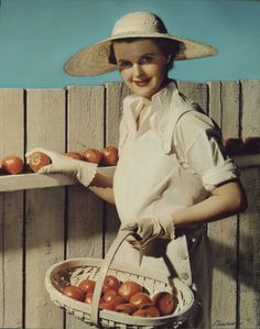 A lovely 1930s woman gathering tomatoes. #vintage #gardening #1930s #homemaker