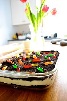 Best Oreo Dirt Pie! No butter or powdered sugar. Pulse 1 pkg oreos until it loks like dirt. Blend 8 oz cream cheese with 1/4 cup sugar. Mix 2 vanilla or choc. pudding packets with 3 cups soymilk. Add to cream cheese. Fold in 1 Cool Whip container. Layer oreos and pudding mix. Top with worms. Refrigerate 2 hours. *For kids- serve in pail!