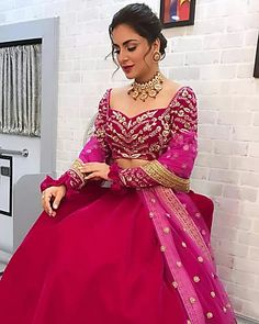 Shraddha Arya sported a dark magenta lehenga and we loved the golden embroidery on the blouse. She accessorised it with gold plated choker necklace and studs. Subtle smokey eyes, wine lips, and a retro bun hairdo complemented her attire beautiful. Indian Bridal Fashion, Indian Wedding Outfits, Indian Outfits, Designer Bridal Lehenga, Bridal Lehenga Choli, Wedding Lehnga, Wedding Dresses, Designer Party Wear Dresses, Indian Designer Outfits