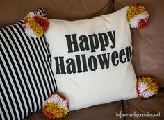 Halloween Decor Ideas | Are you a pom-pom lover like me? These giant candy corn pom-poms are the perfect finishing touch to a fun Halloween pillow!