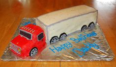 Red and White Semi Truck Cake - This is a Tractor trailer truck cake I made for my daddy for his birthday. He drives for a living and requested one. I made it freehand and was really pleased with how it came out. Its all butter-cream with dragee accents and cookie wheels...thanks for looking!