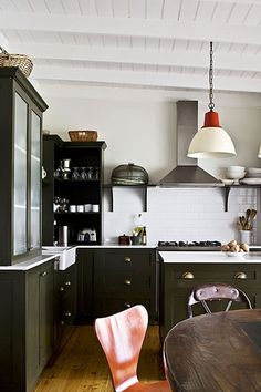 how to get this look: dark green painted cabinets, stainless steel free standing hood, open shelving, marble countertops, white subway tiles. desiretoinspire.net
