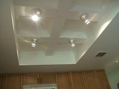 Ideas for the hideous fluorescent soffit lighting in our kitchen