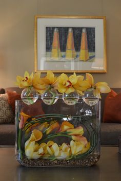 Yellow orchids and flame calla's make for a truly sculptural floral design.