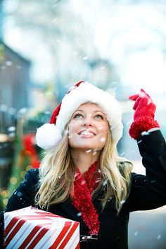 Christmas: Pretty Holiday Shopper Looks Up During Snow by Sean Locke - Christmas, Shopping - Stocksy United Southern Christmas, Christmas In The City, Christmas Mood, The Night Before Christmas, Christmas Colors, Christmas Shopping, Christmas And New Year, Christmas Themes, Black Christmas