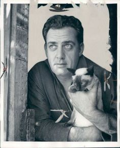 Raymond Burr with his Siamese cat circa 1960s