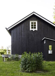 black with white windows and fascia . board and batt siding Black House Exterior, Dark House, Cabins And Cottages, House Colors, Future House, House Design, Fascia Board, West Branch, Bunkhouse