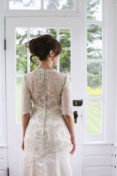 Look at the gorgeous lace detail on this Renate Gerhig Design gown! Photo by Lindsay Borden Photography via JunebugWeddings.com.