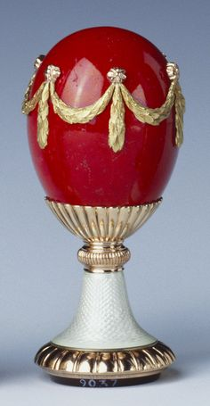 Fabergé egg-shaped seal of gold mounted purpurine with cylindrical handle mounted with ribbed mount and gadrooned cup and reversed cup base; cornelian seal carved with crowned 'MM' monogram. Mark of Michael Perchin. Acquired by Queen Mary. Fabrege Eggs, Royal Collection Trust, Egg And I, Imperial Russia, Egg Art, Egg Shape, Queen Mary, Lassi, Saint Petersburg