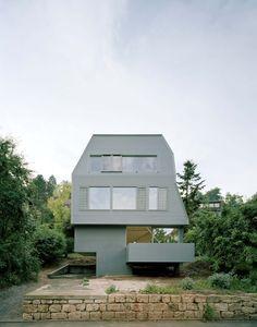 Contemporary interpretation of grey tuff stone buildings by AMUNT Architekten