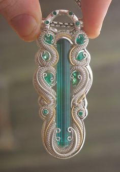 60 mm tourmaline and 12 emeralds heady wire wrap by TendaiDesigns