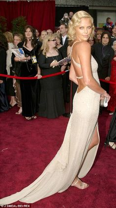 Charlize Theron collected her Oscar for Monster in gold Gucci in 2003